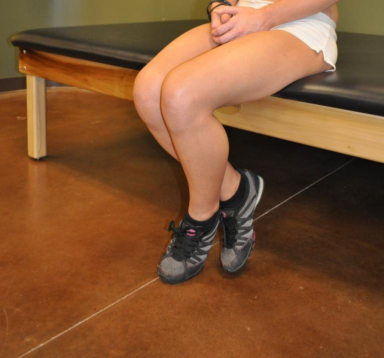Seated knee flexion stretch